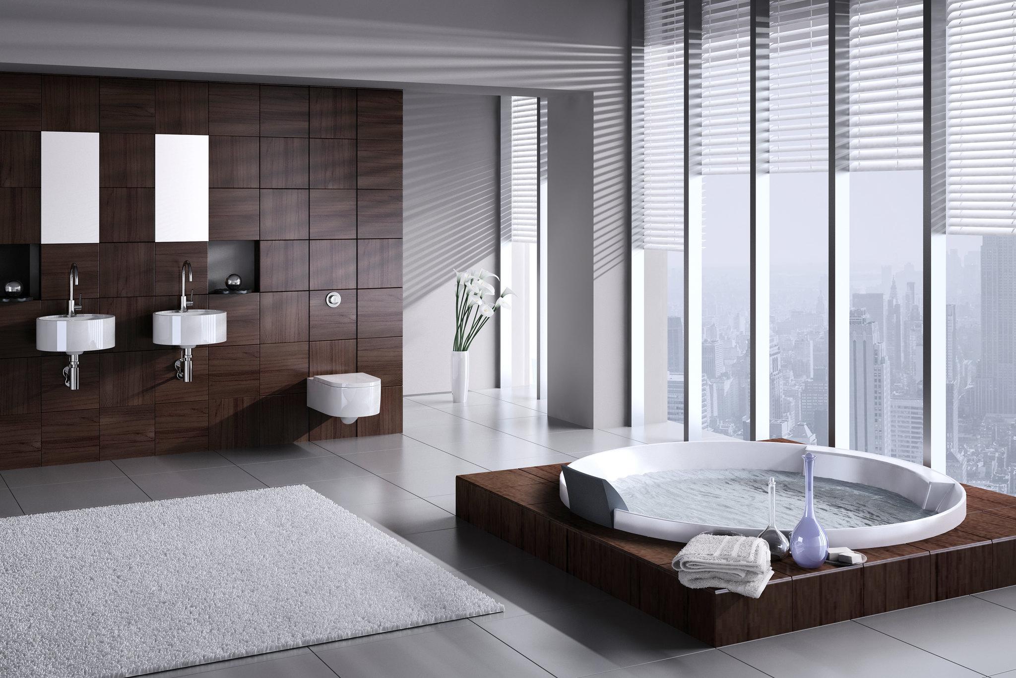 bien aménager une salle de bain décoration intérieure tendance design grande baignoire balnéo ouverture baie vitré meuble sur mesure bois encastré